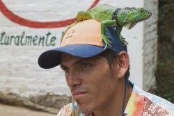 El Salvador Nahuizalco man with iguana on head