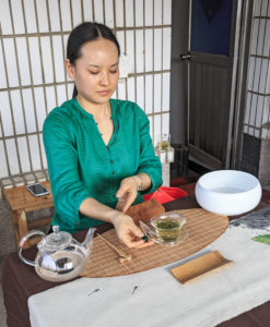 Tea ceremony at Meijiawu Tea Village on the west end of Hangzhou's West Lake. The village is famous for its Longjing (Dragon Well) tea. One million visitors a year get to sample the tea and watch a tea ceremony.